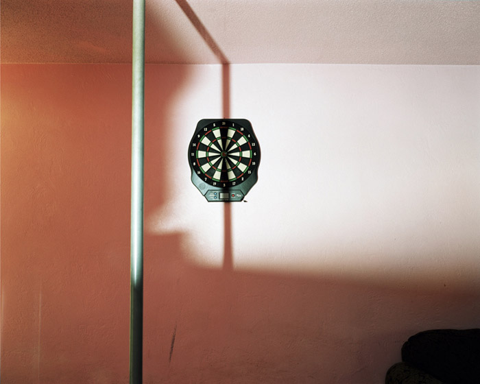 Dartboard and stripper pole at swinger's club, Daytona Beach, Fla. 2005