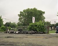 Joe's sign with tires, Trainer, Penna. 2003
