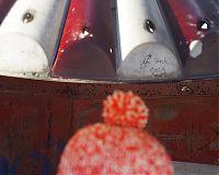 Her winter hat with graffiti at playground, CT, 2016