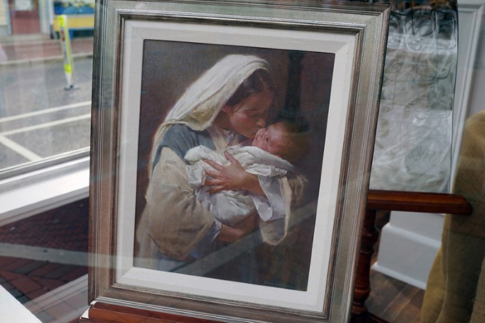 Mother and child painting in window, NJ 2016