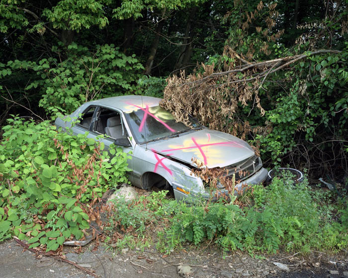 Junked car with three X's, Trainer, Penna. 2003